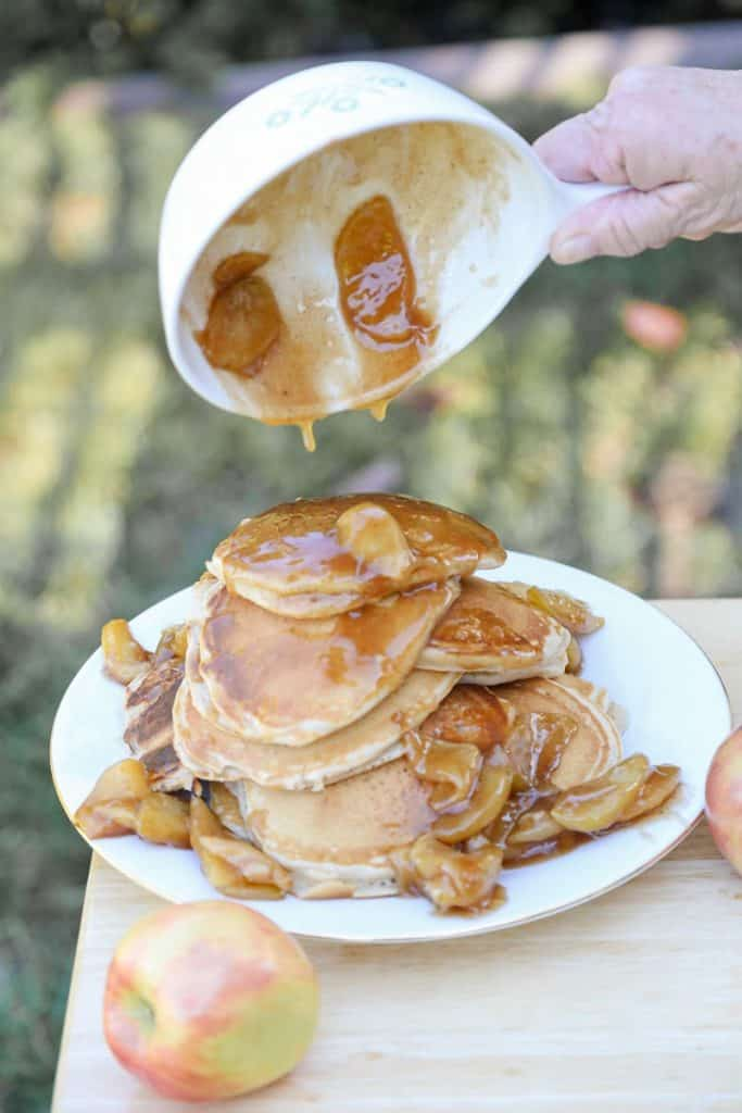 apple granola pancakes with caramel drippings