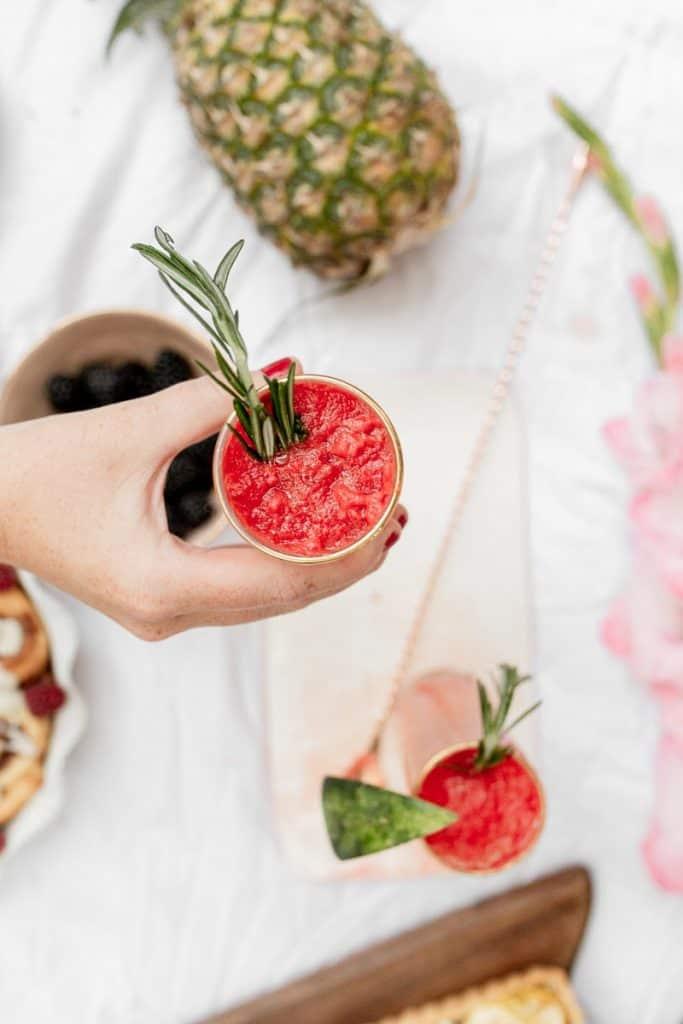 frozen watermelon lemonade overhead in hand