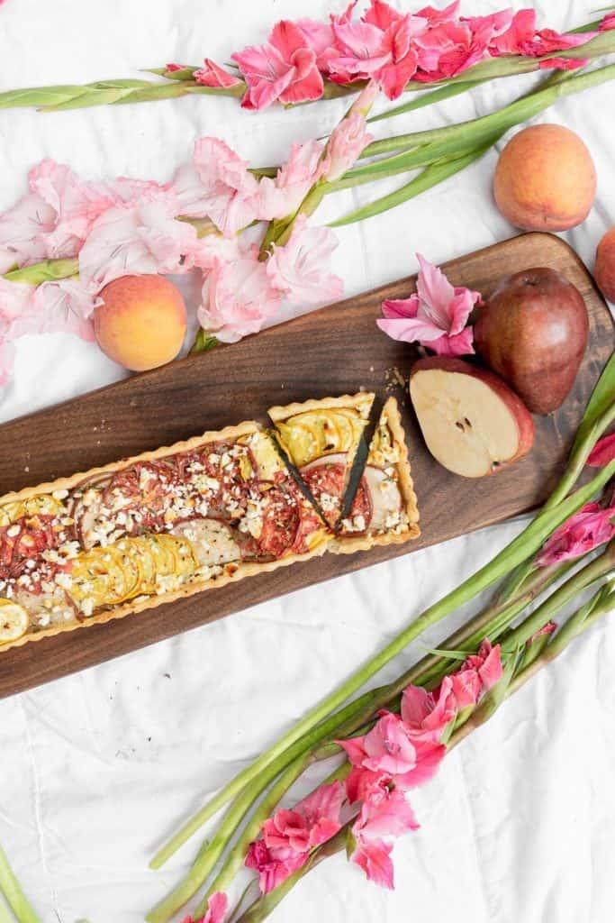 heirloom veggie tart on a board