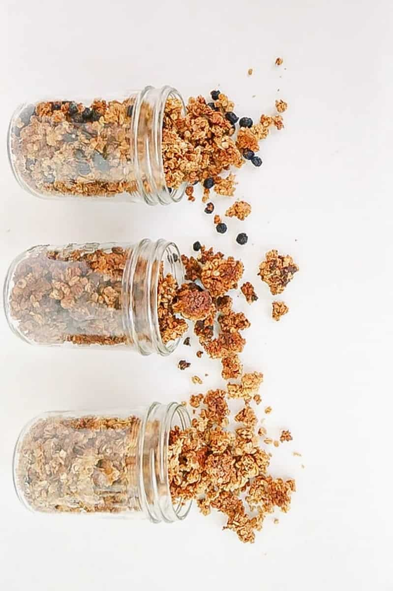homemade granola spilling out of containers