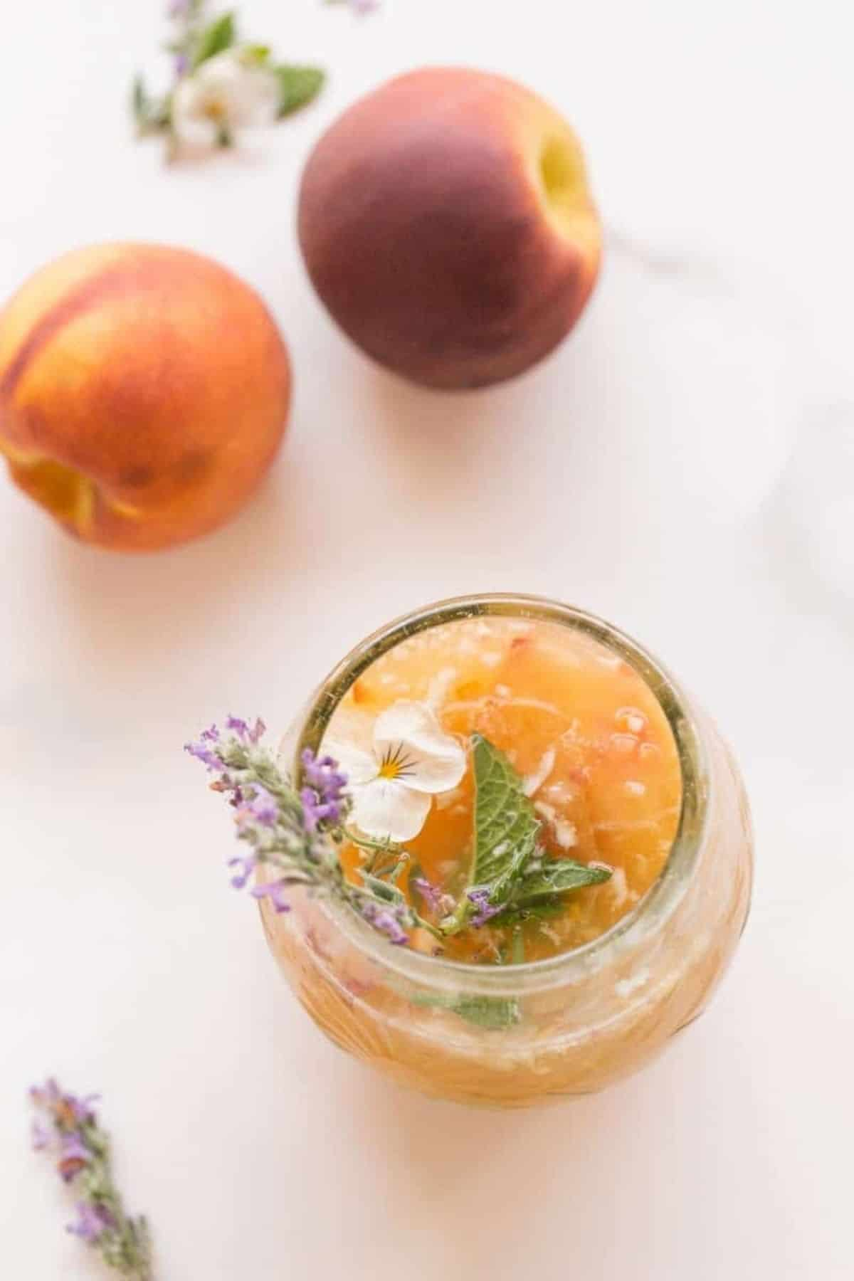 closeup of sangria in glasses and edible flowers