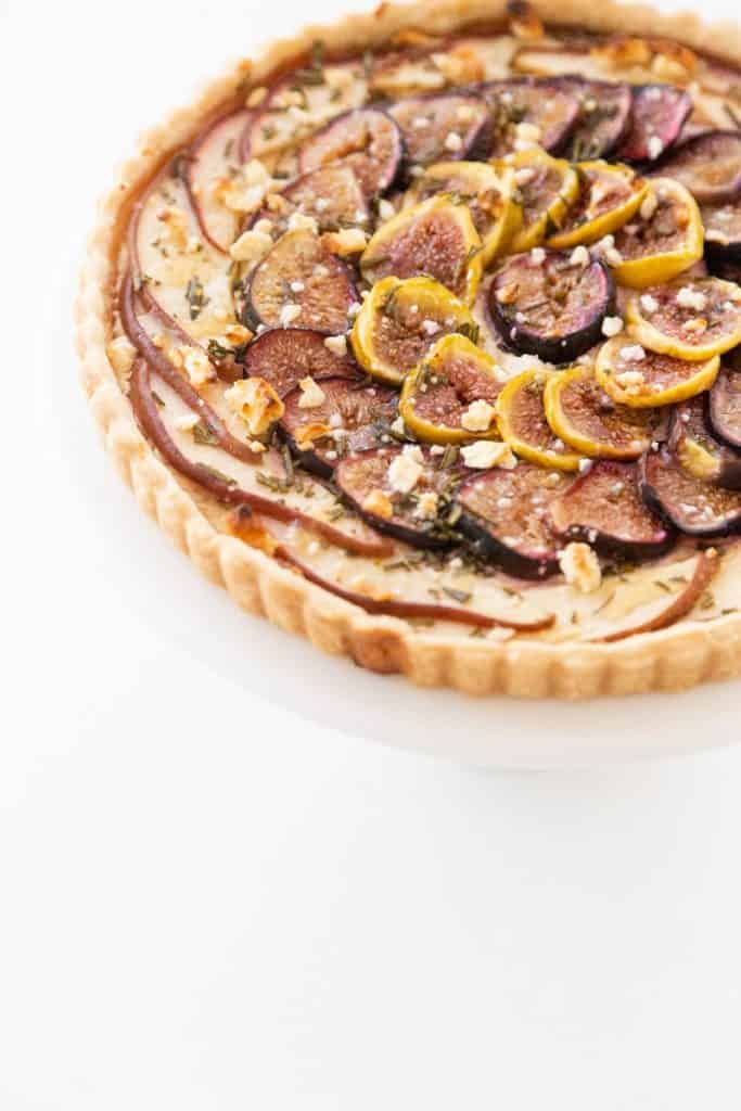 pear and fig tart on a platter