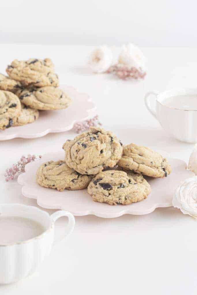 cookies on plate and mugs of milk