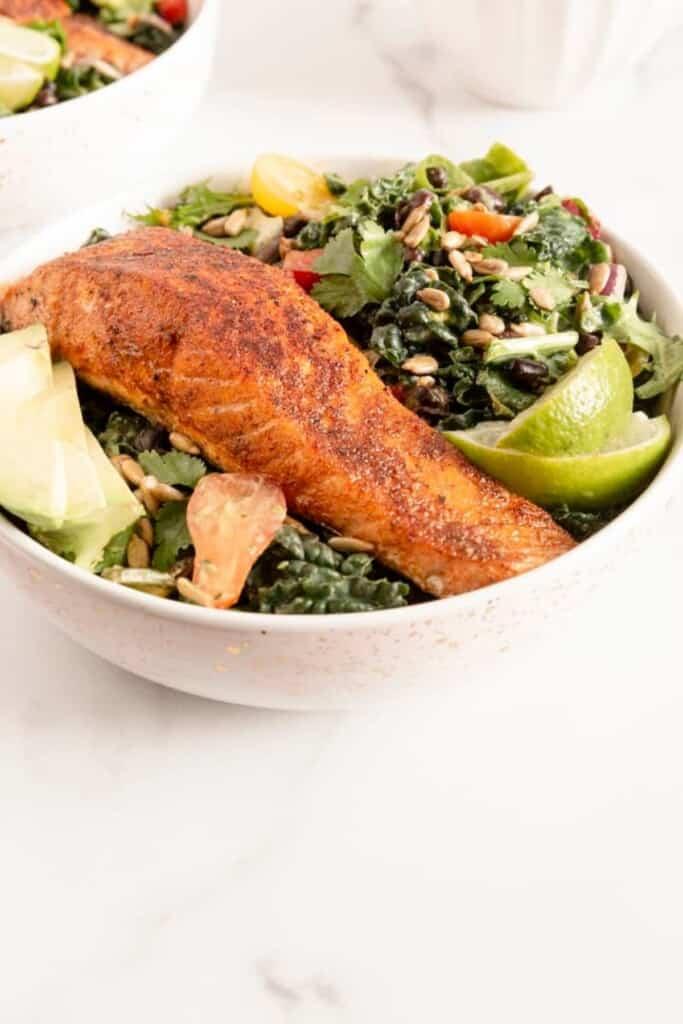 salmon on salad with avocado