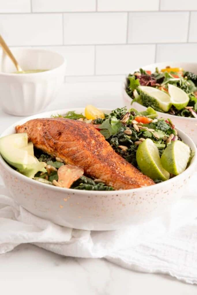 salmon on salad in two bowls