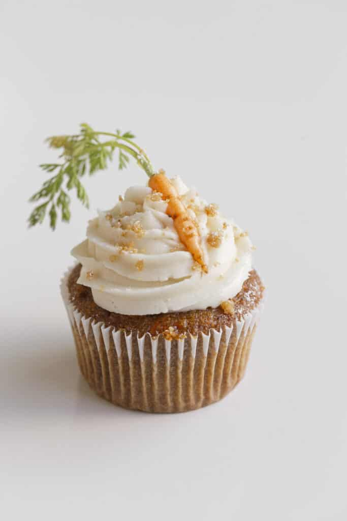 carrot cake for two - cupcake with frosting, crumble, and carrots