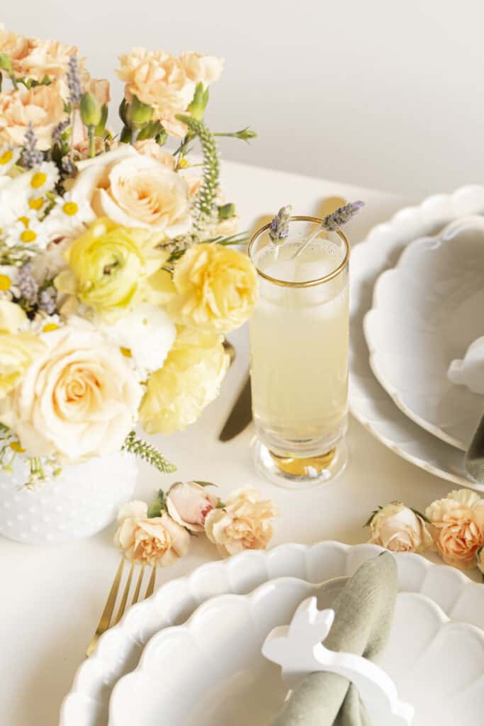 easter tablescape with yellow flowers and lavender cocktail