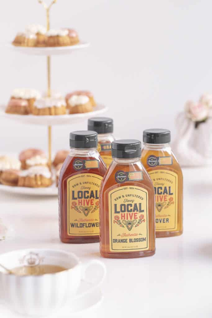 local honey in bottles with honey cakes and tea
