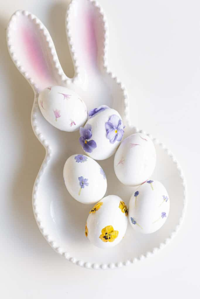 easter eggs on a bunny plate with flowers