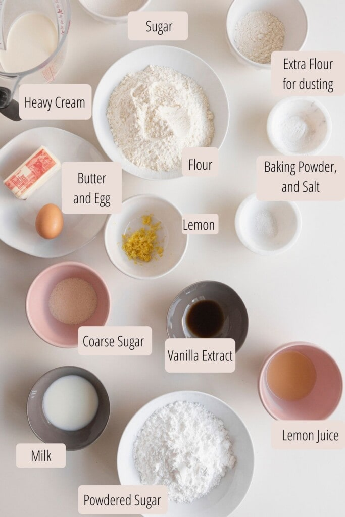 ingredients in bowls for lemon scones on a white surface