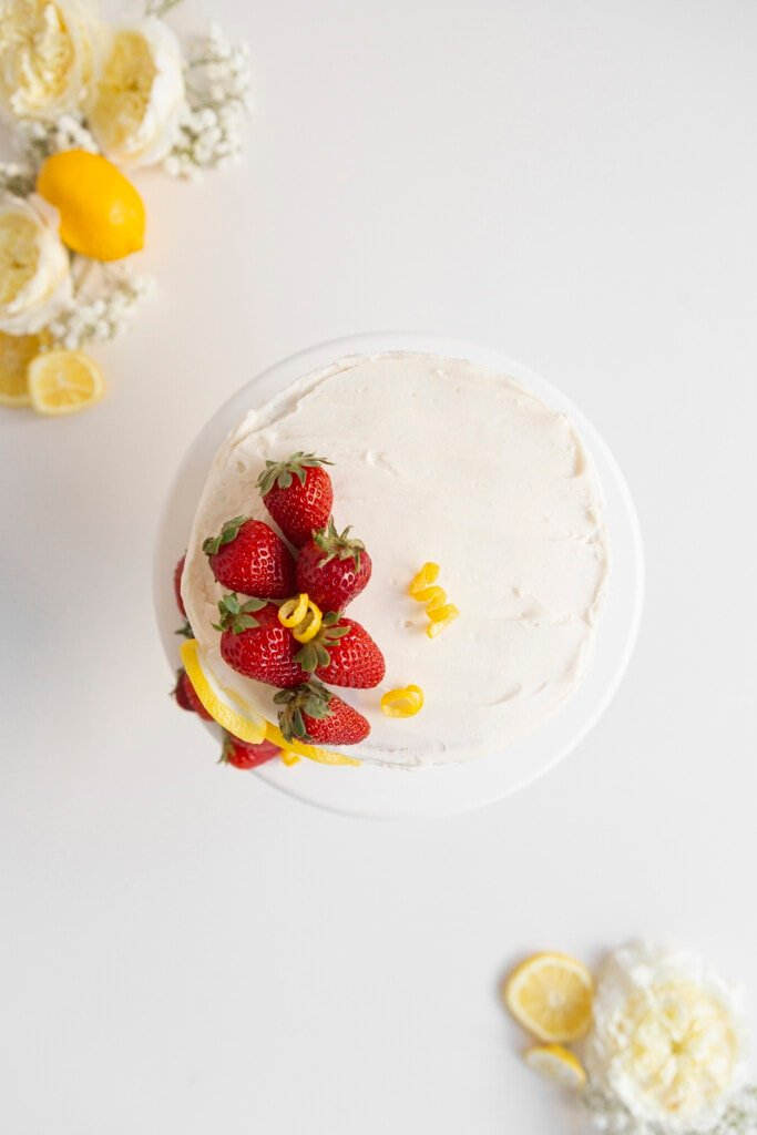 strawberry lemon cake from above with strawberries and flowers