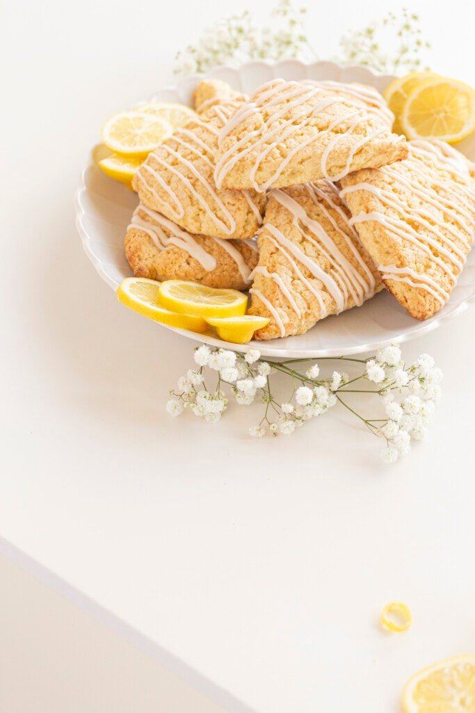 lemon scones on a plate with lemons and flowers