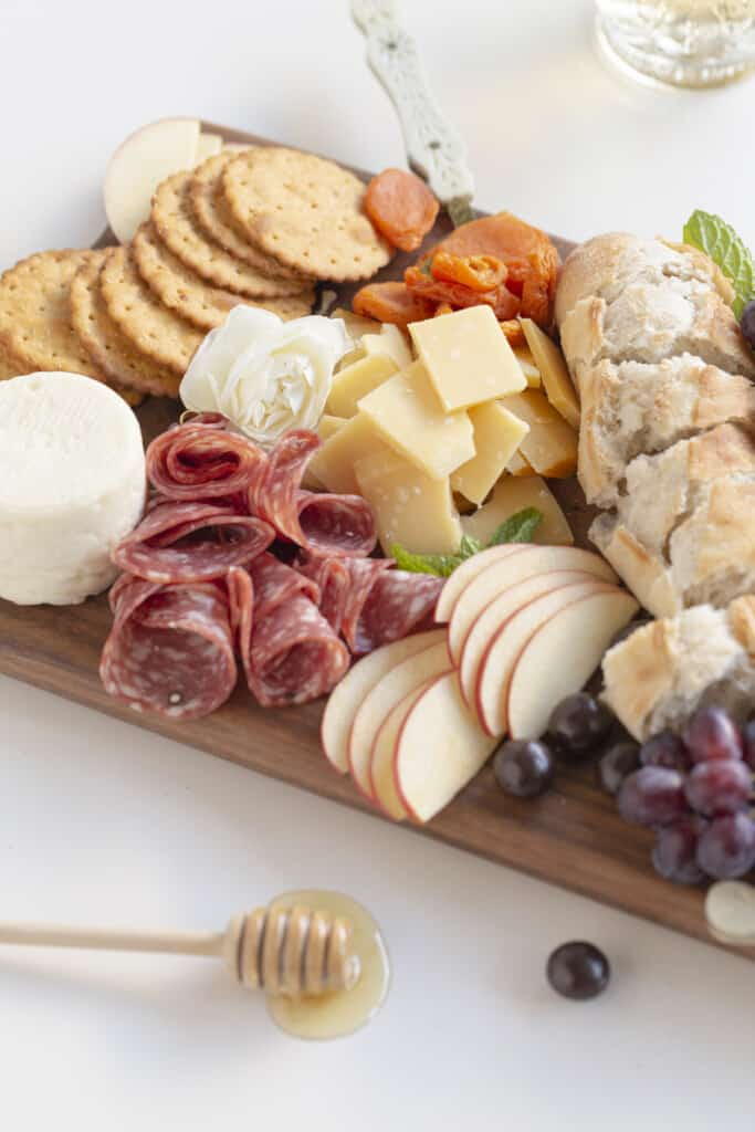 charcuterie board meats and cheese on a board with fruit
