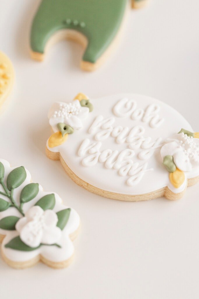 """lemon baby shower cookies with """"oh baby baby"""" written on it"""