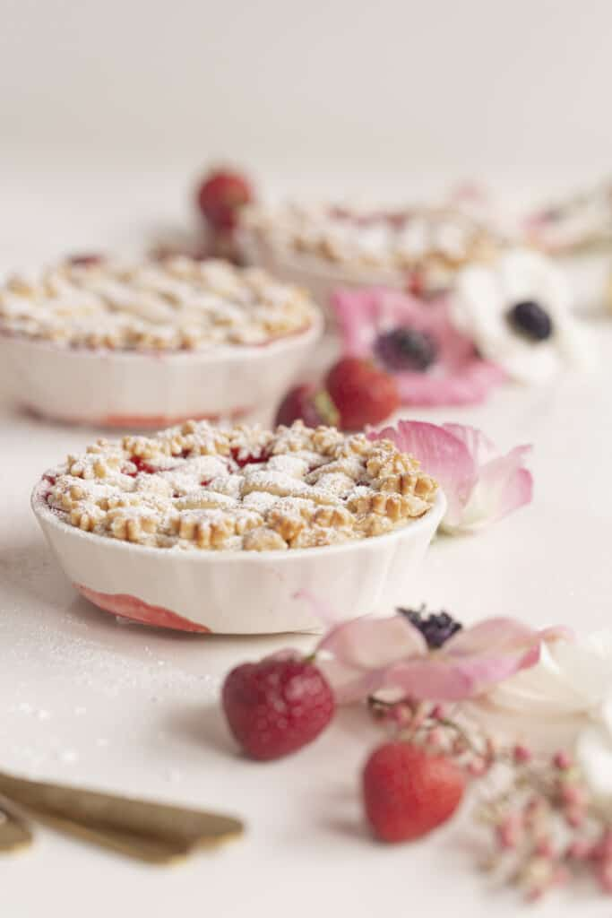 three mini pies with strawberries and flowers